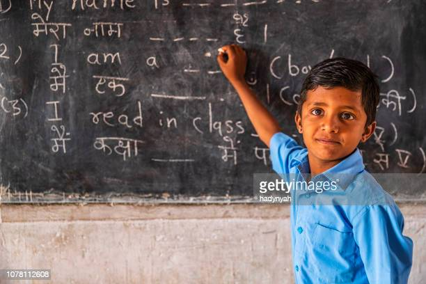 indian schoolboy in classroom - indian culture stock pictures, royalty-free photos & images