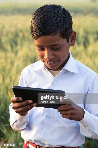 Indian schoolboy looking at tablet device