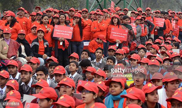 Indian schoolchildren and Vodafone India employees participate in a road safety awareness rally near the landmark India Gate monument in New Delhi on...