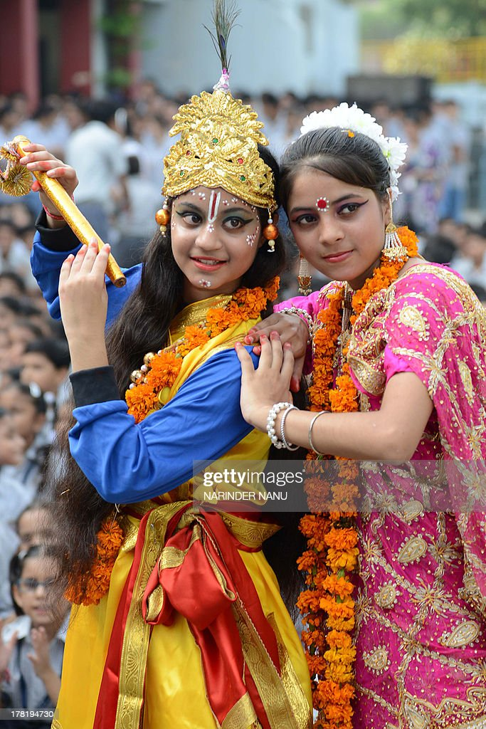 Indian schoolchildren dressed as the Hindu god Krishna and Radha pose on the eve of the Janmashtami festival at a school in Amritsar on August 27...
