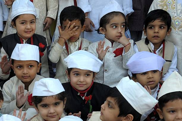 Indian schoolchildren dressed up as India`s first prime minister Jawaharlal Nehru pose during a photo event for Children`s Day celebrations at a...