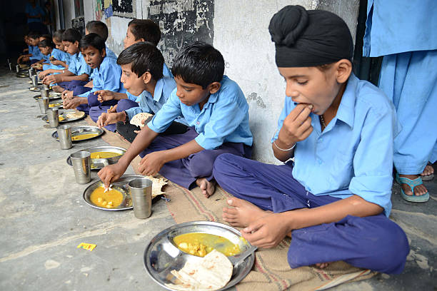 Indian schoolchildren eat their free midday meal at a government school in Amritsar on July 19 2013 Punjab state Education Minister Sikander Singh...