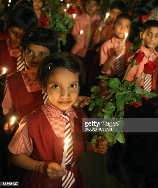 Indian Schoolchildren hold flowers and candles in memory of those killed in the Mumbai attacks in Mumbai on December 1 2008 The attacks on Mumbai...