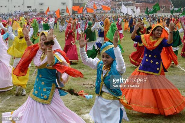 Indian schoolchildren perform during a rehearsal for Independence Day parade celebrations at The Guru Nanak Stadium in Amritsar on August 13 2013...