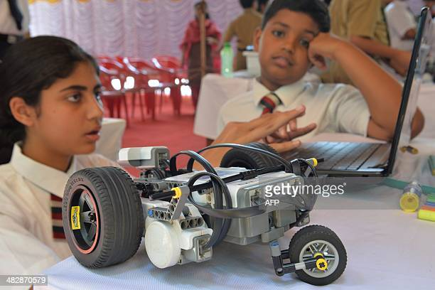 Indian schoolchildren programme a robot using a laptop during the South Indian Zone Finals of the RoboCup Junior Competition in Bangalore on March 5...