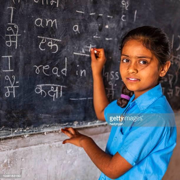 indian schoolgirl in classroom - schoolgirl stock pictures, royalty-free photos & images