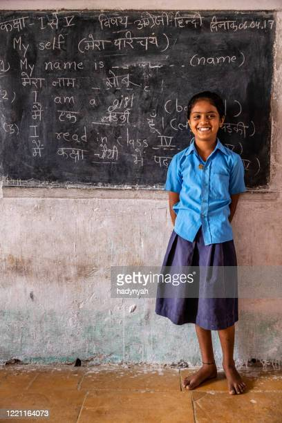 indian schoolgirl in classroom - teenage girls stock pictures, royalty-free photos & images