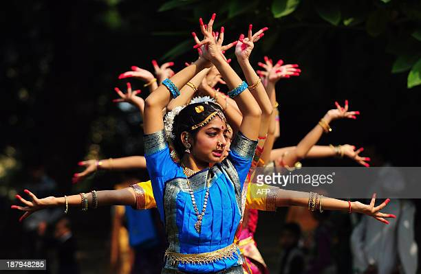Indian schoolgirls participate in a traditional dance to commemorate 124th birth anniversary of India's late first prime minister Jawahar Lal Nehru...