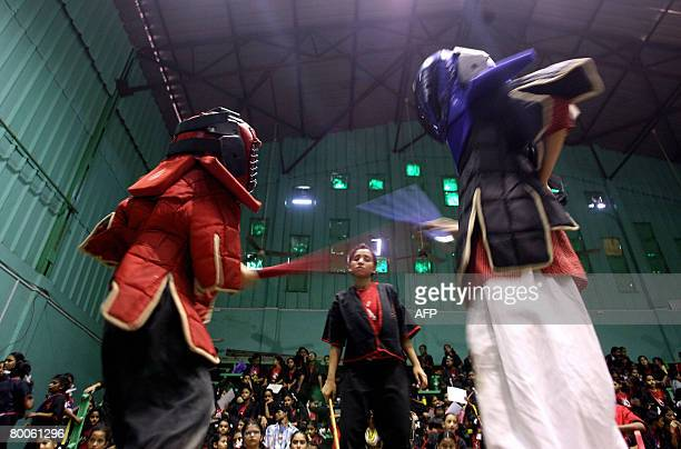 Indian schoolgirls take part in a Eskrima-Kali-Arnis workshop in Mumbai on February 29 as part of a four day workshop in the Philippino Martial Arts...