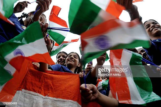 Indian schoolgirls wave Indian flags during a rehearsal for Independence Day parade celebrations at a school in Amritsar on August 11 2010 India's...