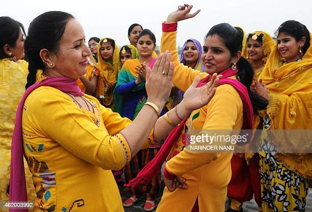 Indian schoolteachers perform the traditional folkdance the 'Giddha' dance for media ahead of the Basant Panchami Spring festival in Amritsar on...