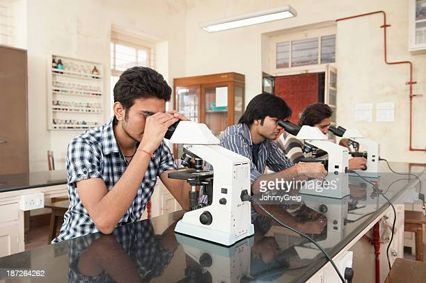 Indian science students using microscopes