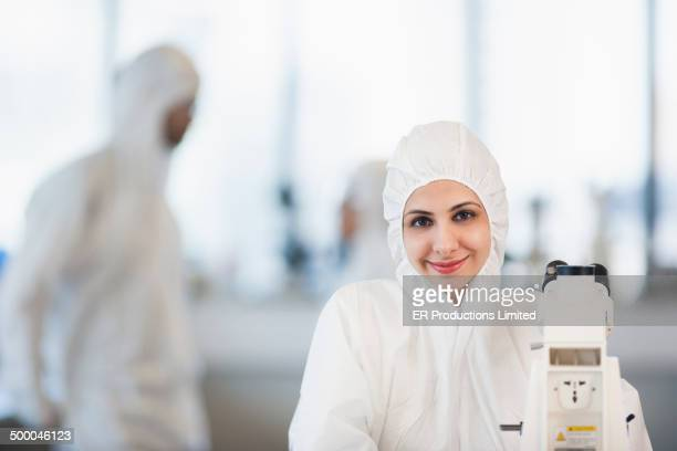 Indian scientist wearing protective gear in lab