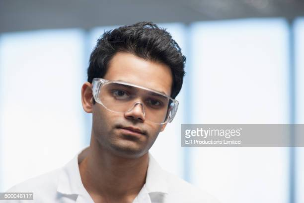 Indian scientist wearing safety goggles in lab