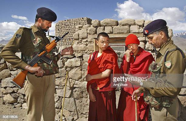 Indian security check the identification of Ladakhi Buddhists from the Thiksey Monastery who wait to cast their votes in the final round of the...