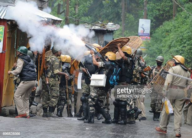 Indian security forces fire tear gas canisters during clashes with supporters of the separatist Gorkha Janmukti Morcha group in Darjeeling on June 17...