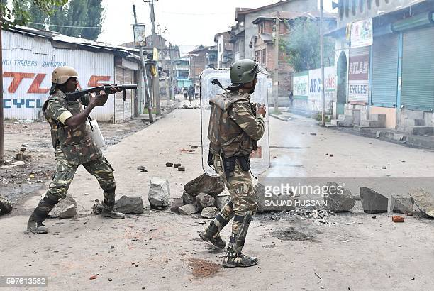 Indian security forces fire teargas shells towards Kashmiri protesters during clashes in Srinagar on August 29 2016 Authorities lifted a curfew in...