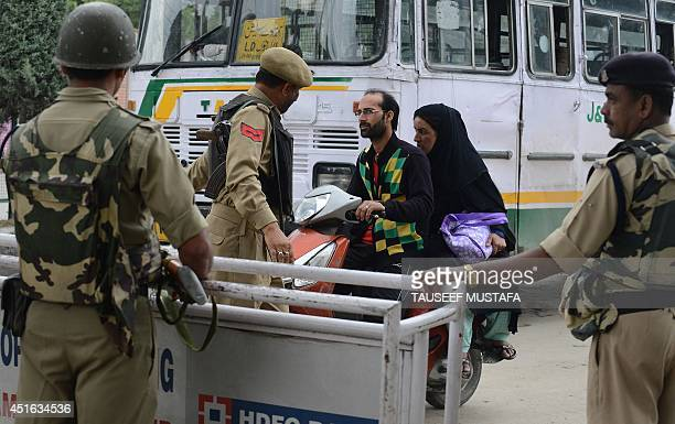 Indian security forces man a roadblock during a random search in Srinagar on July 3 2014 Security has been beefedup in Srinagar on the eve of Prime...