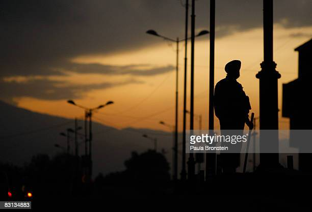 Indian security forces stand guard during a curfew October 5 2008 in Srinagar Kashmir India A strict curfew in Indian Kashmir was imposed starting...
