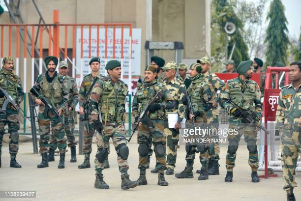 Indian security forces stand guard near the IndiaPakistan border in Wagah on March 1 as they wait for the return of an Indian Air Force pilot being...