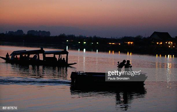 Indian security patrols on Dal Lake October 7 2008 in Srinagar Kashmir In the past few months the region's summer captiol has witnessed the biggest...