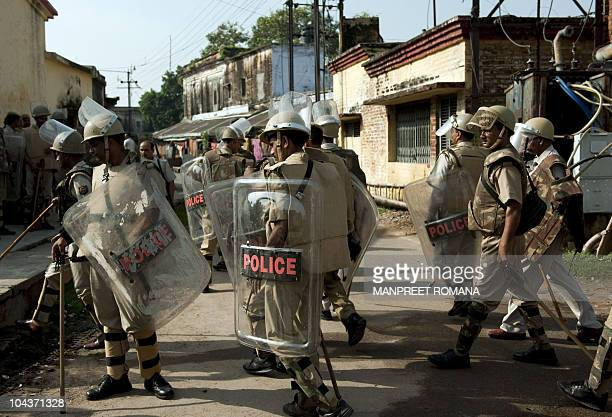 Indian security personnel arrive to patrol the streets of Ayodhya on September 23 ahead of the verdict on the Babri Masjid site India has increased...