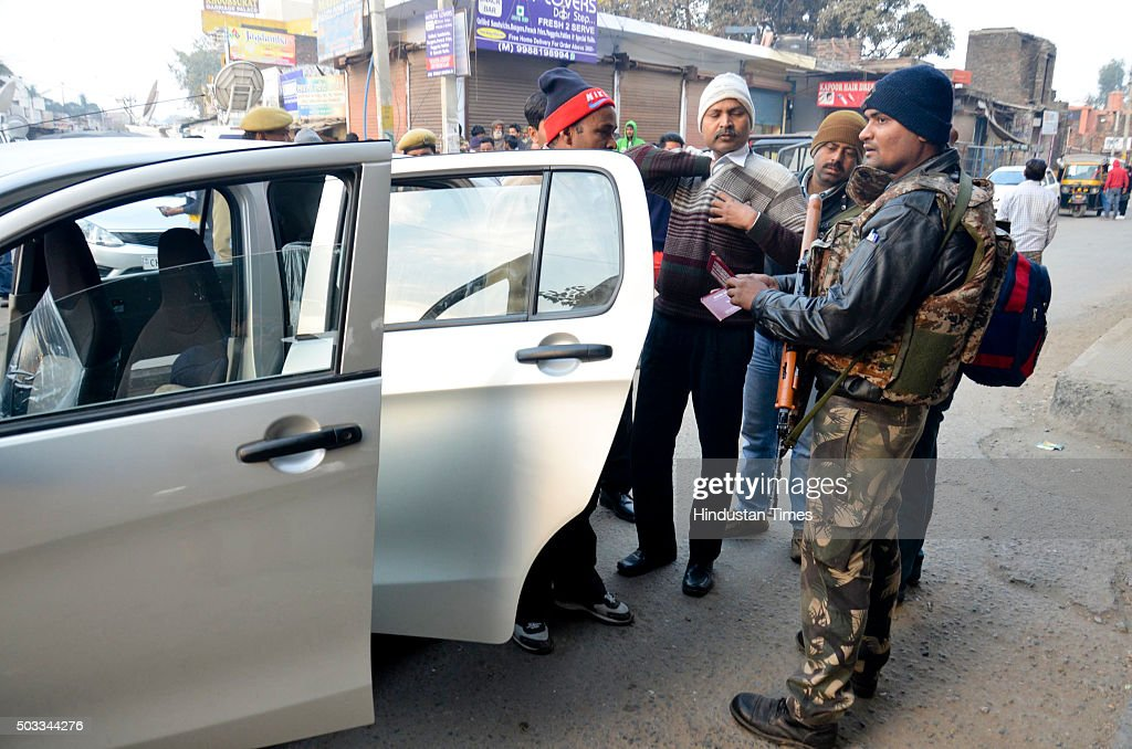 Indian security personnel check vehicles during a terror strike at Pathankot Air Force Base on January 4 2015 in Pathankot India Seven soldiers and...