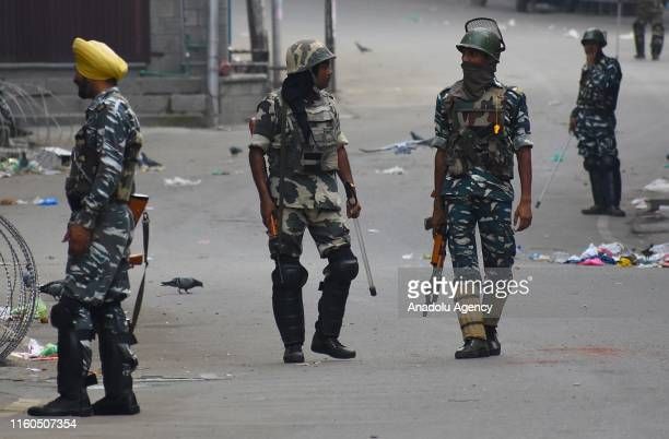 Indian security personnel patrol on a street during a curfew in Srinagar Kashmir India on August 07 2019 The government has suspended internet and...