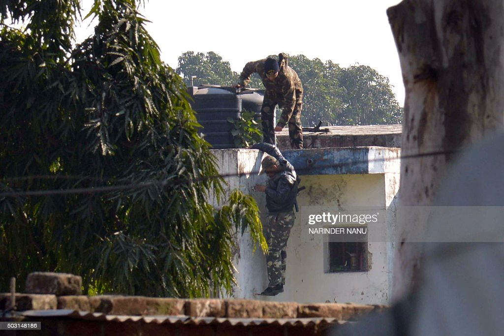 Indian security personnel position themselves on a rooftop at an airforce base in Pathankot on January 2 during an ongoing attack on the base in the..