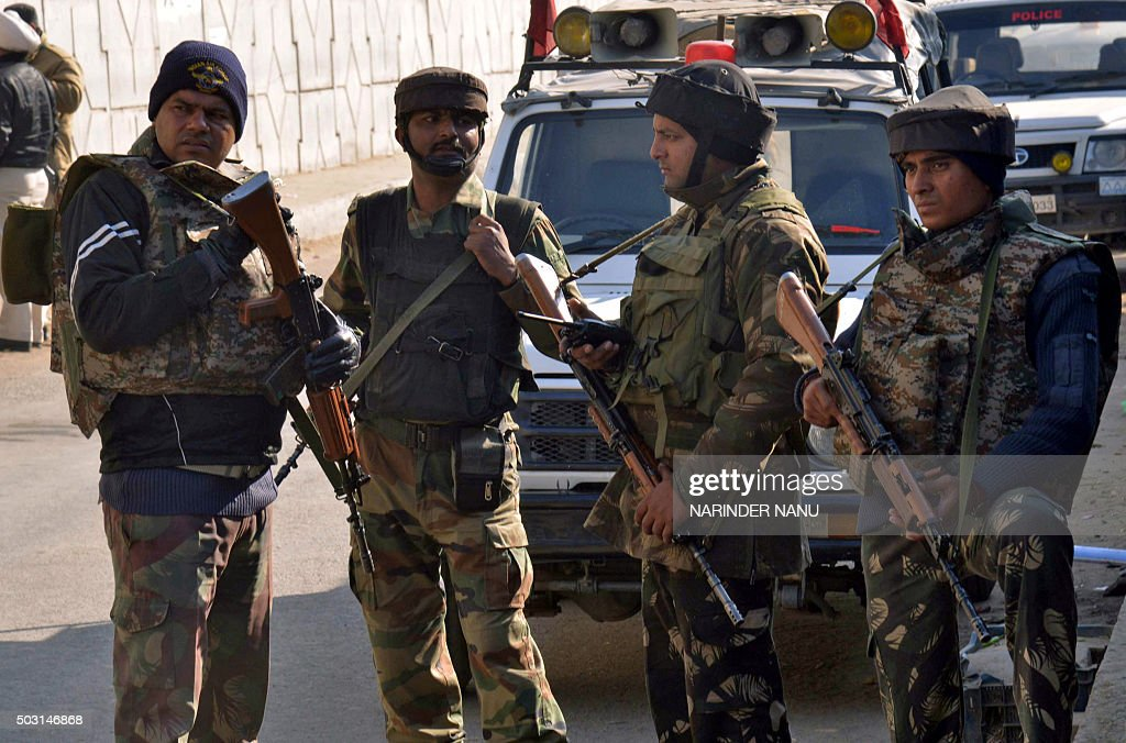 Indian security personnel stand alert on a road leading to an airforce base in Pathankot on January 2 during an ongoing attack on the base in the...