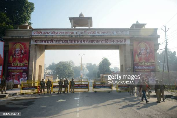 Indian Security personnel stand guard along a road during 'Dharam Sabha' Hindu congregation held to call for the construction of a grand temple of...