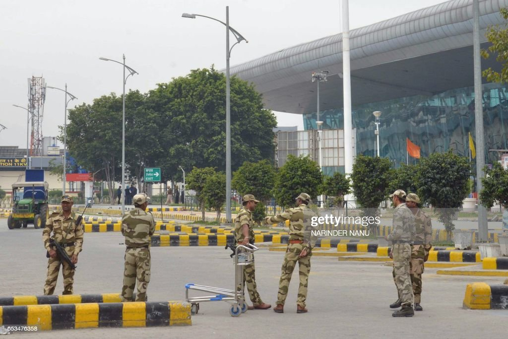 Indian security personnel stand guard at Amritsar airport after an abandoned briefcase triggered a bomb scare and prompted flights to be suspended in.