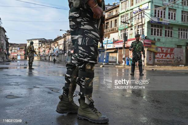 Indian security personnel stand guard on a street during a curfew in Srinagar on August 8 as widespread restrictions on movement and a...