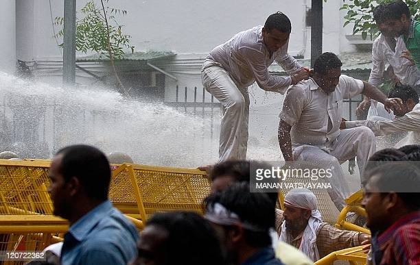 Indian security personnel unleash water cannons to disperse Bharatiya Janata Party Youth activists during a protest in New Delhi on August 9 2011 An...