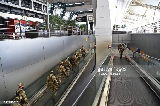 Indian security personnels patrol at Indira Gandhi International Airport during a governmentimposed nationwide lockdown as a preventive measure...