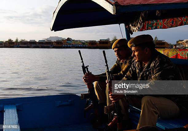 Indian security stands guard on Dal Lake October 7 2008 in Srinagar Kashmir In the past few months the region's summer captiol has witnessed the...