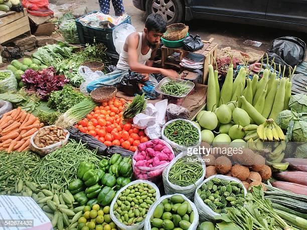 Indian Seller waiting for customerThe vegetable daily market in Central Kolkata on 23 June 2016 Congress organises protests against rise in vegetable...