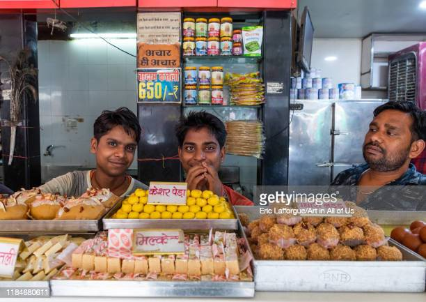 Indian sellers in a sweet shop Rajasthan Bikaner India on July 25 2019 in Bikaner India