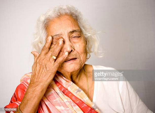 Indian Senior woman in Pain Health Problems