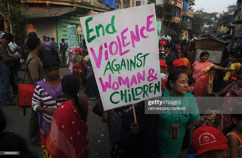 Indian sex worker's children walk in a rally to protest against social discrimination in Kolkata on December 10, 2012. The rally was organised to celebrate World Human Right's Day and to raise voices for equal rights and against social discrimination. AFP PHOTO/Dibyangshu SARKAR
