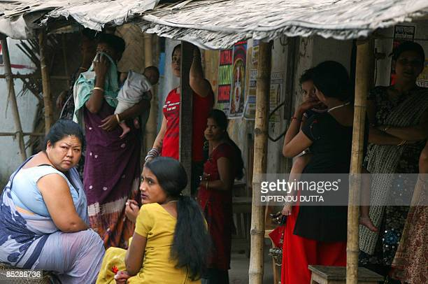 Indian sex workers look on during a fashion show organised at the Khalpara red light area in Siliguri on March 7 2009 on the eve on International...