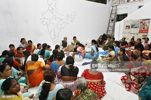Indian sex workers perform a ritual in observance of 'Bhai Phonta' festival in Kolkata on October 30 2008 Bhai Phonta is a festival where sisters...