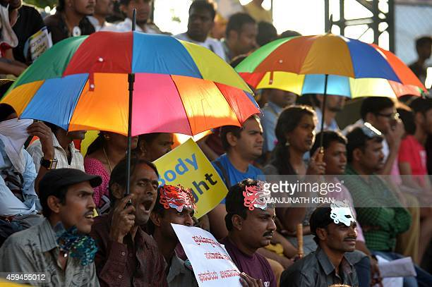 Indian sexual minority and gayrights activists take part in the annual Bengaluru Pride March in Bangalore on November 23 2014 The annual march is...