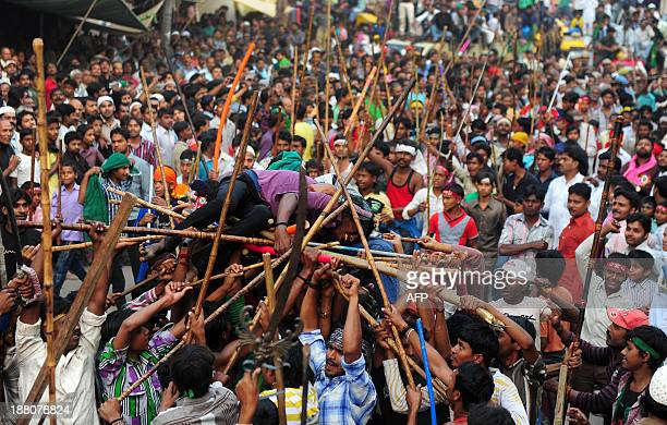 Indian Shiite Muslim devotees mourn with sticks during a religious procession marking Ashura in Allahabad November 15 2013 Ashura mourns the death of...