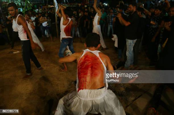 Indian shiite muslims beat their chests and flagellate with blades to mark midnight Ashura procession in the old streets of Allahabad on October...