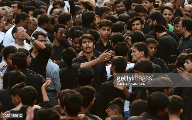 Indian Shiite Muslims devotees beat their chests with their hands during a Chehlum procession in Allahabad on October 30 2018 Chehlum is the fortieth...