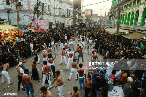 Indian Shiite Muslims devotees perform a ritual of selfflagellation during a Chehlum procession in Allahabad on October 30 2018 Chehlum is the...