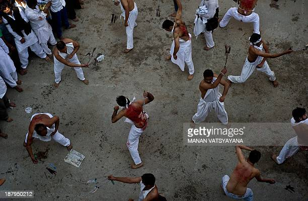 Indian Shi'ite Muslims flagellate themselves during a Muharram procession on the eighth day before Ashura in Amroha some 140kms east of New Delhi on...