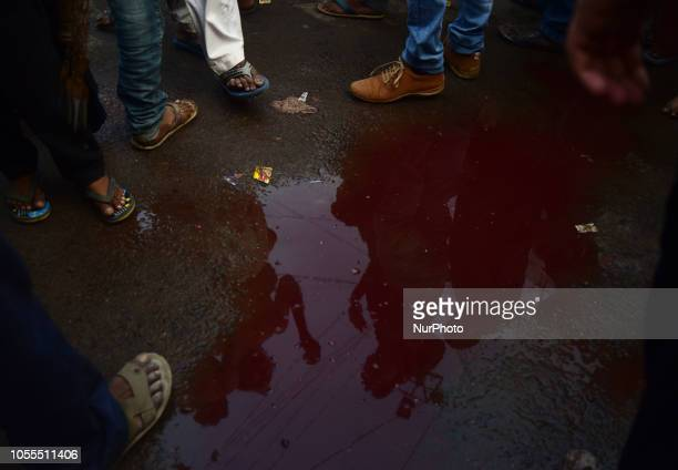 Indian shiite muslims flagellate themselves with blades as their shadows appear in blood during a religious procession on Arbeen 40th day after...