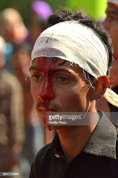 Indian Shiite Muslims flagellates himself during a procession to mark Ashoura India Shiitee Muslims commemorate the killing of Imam Hussain the...
